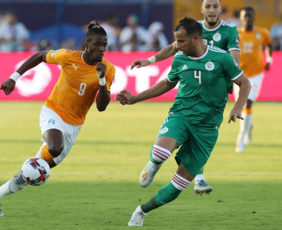 Wilfried Zaha of Ivory Coast challenged by Amir Bensebaini and Djamel Benlamri of Algeria during the 2019 Africa Cup of Nations Finals, quarterfinals match between Ivory Coast and Algeria at Suez Stadium, Suez, Egypt on 11 July 2019 ©Samuel Shivambu/BackpagePix