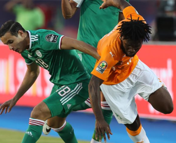 Franck Kessie of Ivory Coast challenged by Mohamed Belaili of Algeria during the 2019 Africa Cup of Nations Finals, quarterfinals match between Ivory Coast and Algeria at Suez Stadium, Suez, Egypt on 11 July 2019 ©Samuel Shivambu/BackpagePix