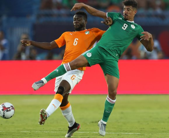 Baghdad Bounedjah of Algeria challenged by Ismael Traore of Ivory Coast during the 2019 Africa Cup of Nations Finals, quarterfinals match between Ivory Coast and Algeria at Suez Stadium, Suez, Egypt on 11 July 2019 ©Samuel Shivambu/BackpagePix