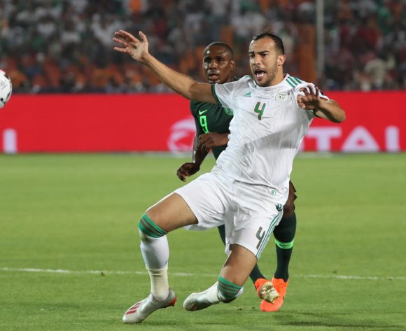 Djamel Benlamri of Algeria fouled by Odion Jude Ighalo of Nigeria during the 2019 Africa Cup of Nations Finals Semifinal football match between Algeria and Nigeria at the Cairo International Stadium, Cairo, Egypt on 14 July 2019 ©Gavin Barker/BackpagePix