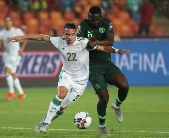 Ismael Bennacer of Algeria challenged by Peter Etebo of Nigeria during the 2019 Africa Cup of Nations Finals Semifinal football match between Algeria and Nigeria at the Cairo International Stadium, Cairo, Egypt on 14 July 2019 ©Gavin Barker/BackpagePix