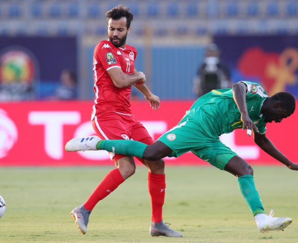 Taha Yassine Khenissi of Tunisia challenged by Papa Alioune Ndiaye of Senegal  during the 2019 Africa Cup of Nations Semifinals match between Senegal and Tunisia at the 30 June Stadium, Cairo on the 14 July 2019 ©Muzi Ntombela/BackpagePix