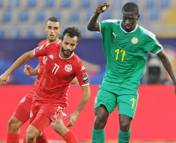 Papa Alioune Ndiaye of Senegal shields is challenged by Taha Yassine Khenissi of Tunisia during the Africa Cup of Nations 2019 Finals semifinal game between Senegal and Tunisia at 30 June Stadium in Cairo, Egypt on 14 July 2019 © Ryan Wilkisky/BackpagePix
