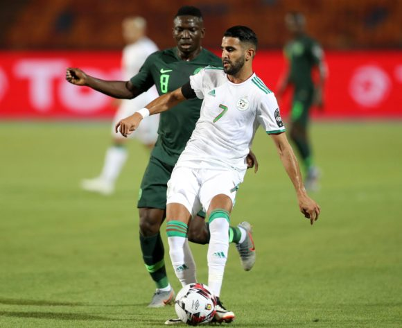 Riyad Mahrez of Algeria challenged by Peter Etebo of Nigeria during the 2019 Africa Cup of Nations Finals, Semifinals match between Algeria and Nigeria at Cairo International Stadium, Cairo, Egypt on 14 July 2019 ©Samuel Shivambu/BackpagePix