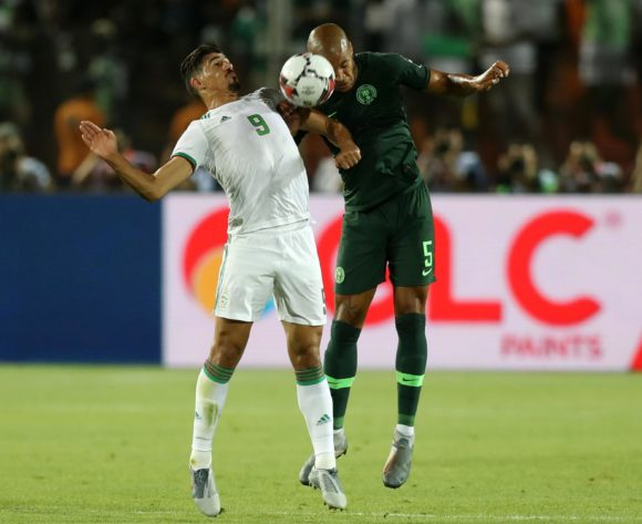Baghdad Bounedjah of Algeria challenged by William Paul Ekong of Nigeria during the 2019 Africa Cup of Nations Finals, Semifinals match between Algeria and Nigeria at Cairo International Stadium, Cairo, Egypt on 14 July 2019 ©Samuel Shivambu/BackpagePix