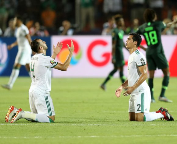 Djamel Benlamri and Aissa Mandi of Algeria celebrates teammates goal during the 2019 Africa Cup of Nations Finals, Semifinals match between Algeria and Nigeria at Cairo International Stadium, Cairo, Egypt on 14 July 2019 ©Samuel Shivambu/BackpagePix