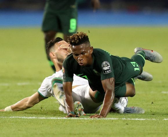 Samuel Chukwueze of Nigeria tackled by Rami Bensebaini of Algeria during the 2019 Africa Cup of Nations Finals, Semifinals match between Algeria and Nigeria at Cairo International Stadium, Cairo, Egypt on 14 July 2019 ©Samuel Shivambu/BackpagePix