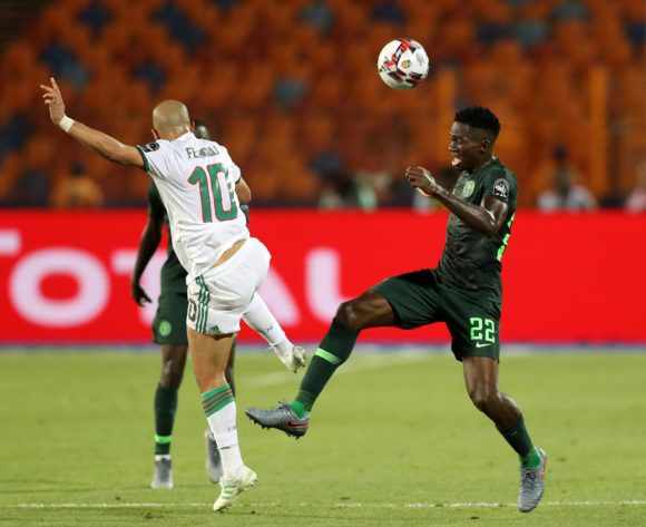 Josiah Kenneth Omeruo of Nigeria challenged by Sofiane Feghouli of Algeria during the 2019 Africa Cup of Nations Finals, Semifinals match between Algeria and Nigeria at Cairo International Stadium, Cairo, Egypt on 14 July 2019 ©Samuel Shivambu/BackpagePix