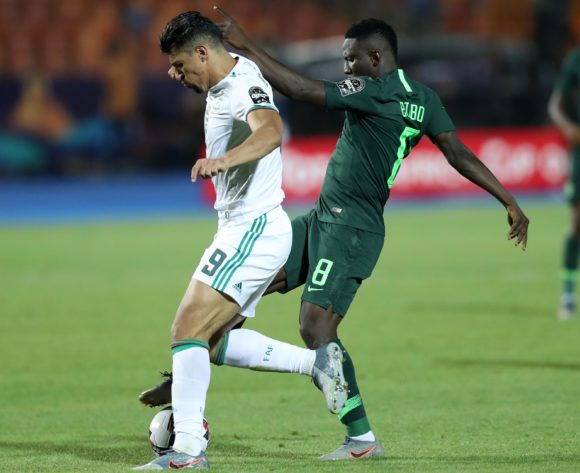Baghdad Bounedjah of Algeria challenged by Peter Etebo of Nigeria during the 2019 Africa Cup of Nations Finals, Semifinals match between Algeria and Nigeria at Cairo International Stadium, Cairo, Egypt on 14 July 2019 ©Samuel Shivambu/BackpagePix