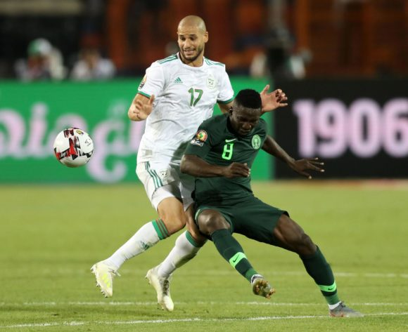 Peter Etebo of Nigeria challenged by Adlane Guedioura of Algeria during the 2019 Africa Cup of Nations Finals, Semifinals match between Algeria and Nigeria at Cairo International Stadium, Cairo, Egypt on 14 July 2019 ©Samuel Shivambu/BackpagePix