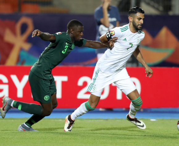 Riyad Mahrez of Algeria challenged by Jamilu Collins of Nigeria during the 2019 Africa Cup of Nations Finals, Semifinals match between Algeria and Nigeria at Cairo International Stadium, Cairo, Egypt on 14 July 2019 ©Samuel Shivambu/BackpagePix