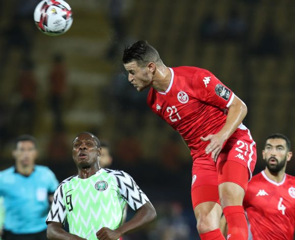 Nassim Hnid of Tunisia clears ball from Odion Jude Ighalo of Nigeria during the 2019 Africa Cup of Nations 3rd and 4th Place match between Tunisia and Nigeria at the Al Salam Stadium, Cairo on the 17 July 2019 ©Muzi Ntombela/BackpagePix