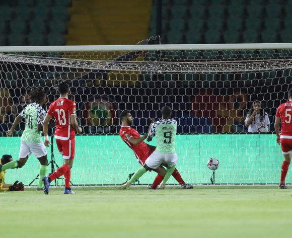 Odion Jude Ighalo of Nigeria score a goal pass Moez Ben Cherifia of Tunisia during the 2019 Africa Cup of Nations Finals, 3rd and 4th place match between Tunisia and Nigeria at Al Salam Stadium, Cairo, Egypt on 17 July 2019 ©Samuel Shivambu/BackpagePix