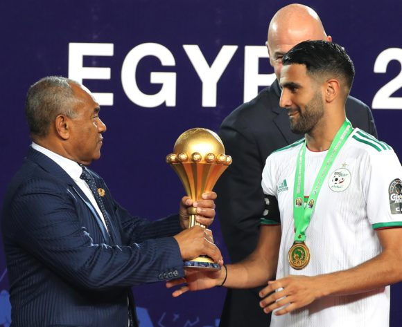 Riyad Mahrez of Algeria receives trophy from CAF President Ahmad during the 2019 Africa Cup of Nations Finals Final football match between Senegal and Algeria at the Cairo International Stadium, Cairo, Egypt on 19 July 2019 ©Gavin Barker/BackpagePix