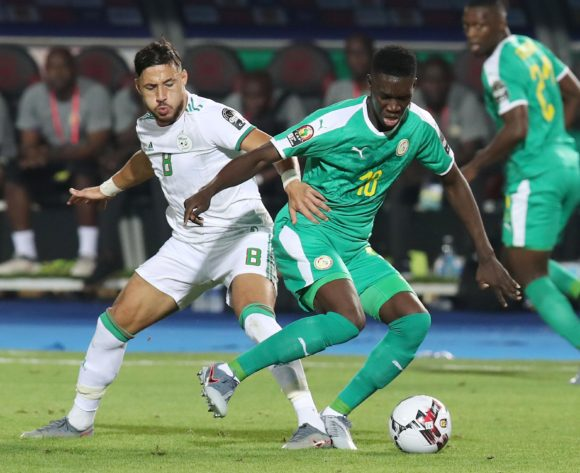 Mohamed Belaili of Algeria challenges Ismaila Sarr of Senegal during the 2019 Africa Cup of Nations Final match between Senegal and Algeria at the Cairo International Stadium, Cairo on the 19 July 2019 ©Muzi Ntombela/BackpagePix