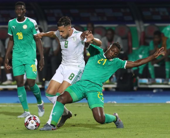 Mohamed Belaili of Algeria challenged by Lamine Gassama of Senegal  during the 2019 Africa Cup of Nations Final match between Senegal and Algeria at the Cairo International Stadium, Cairo on the 19 July 2019 ©Muzi Ntombela/BackpagePix