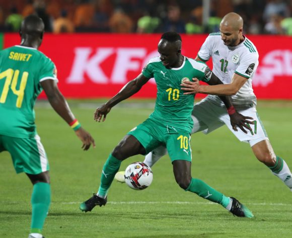 Sadio Mane of Senegal challenged by Adlane Guedioura of Algeria during the 2019 Africa Cup of Nations Final match between Senegal and Algeria at the Cairo International Stadium, Cairo on the 19 July 2019 ©Muzi Ntombela/BackpagePix