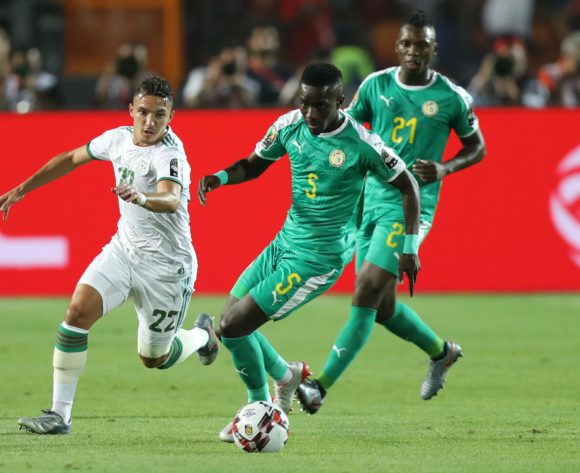 Idrissa Gana Gueye of Senegal challenged by Ismael Bennacer of Algeria during the 2019 Africa Cup of Nations Finals, Final match between Senegal and Algeria at Cairo International Stadium, Cairo, Egypt on 19 July 2019 ©Samuel Shivambu/BackpagePix