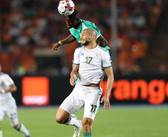 Adlane Guedioura of Algeria challenged by Henri Saivet of Senegal  during the 2019 Africa Cup of Nations Finals, Final match between Senegal and Algeria at Cairo International Stadium, Cairo, Egypt on 19 July 2019 ©Samuel Shivambu/BackpagePix