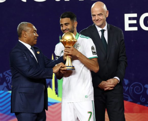 Riyad Mahrez of Algeria receive a trophy from CAF President Ahmad and FIFA President Gianni Infantino during the 2019 Africa Cup of Nations Finals, Final match between Senegal and Algeria at Cairo International Stadium, Cairo, Egypt on 19 July 2019 ©Samuel Shivambu/BackpagePix