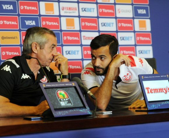 Alain Giresse, head coach of Tunisia and Taha Yassine Khenissi of Tunisia chat during the Africa Cup of Nations 2019 Finals semifinal press conference for Tunisia at 30 June Stadium in Cairo, Egypt on 13 July 2019 © Ryan Wilkisky/BackpagePix
