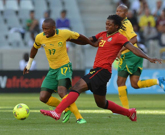Bernard Parker of South Africa gets away from Guilherme Manhique of Mozambique during the 2014 CAF African Nations Championships Group A football match between South Africa and Mozambique at Cape Town Stadium, Cape Town on 11 January 2014