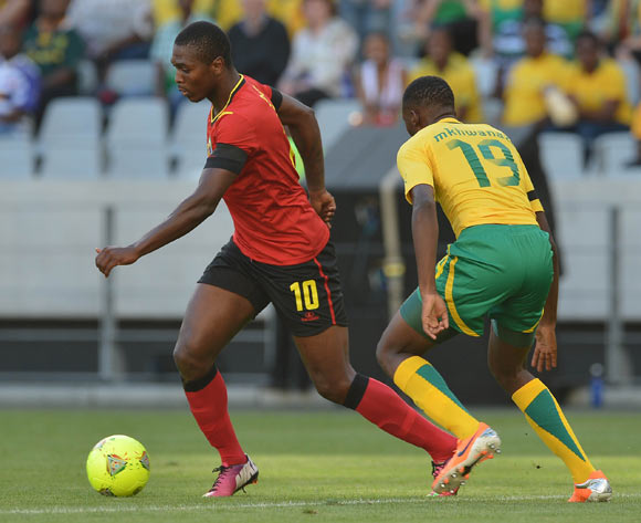 Apsone Manjate of Mozambique evades challenge from Buhle Mkhwanazi of South Africa during the 2014 CAF African Nations Championships Group A football match between South Africa and Mozambique at Cape Town Stadium, Cape Town on 11 January 2014