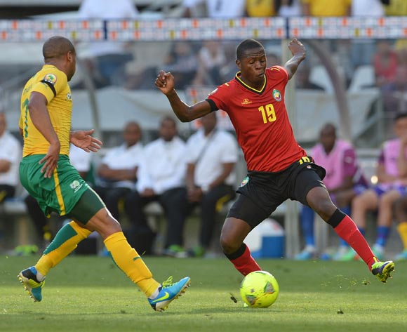 Alanio Mafumo of Mozambique evades challenge from Bryce Moon of South Africa during the 2014 CAF African Nations Championships Group A football match between South Africa and Mozambique at Cape Town Stadium, Cape Town on 11 January 2014