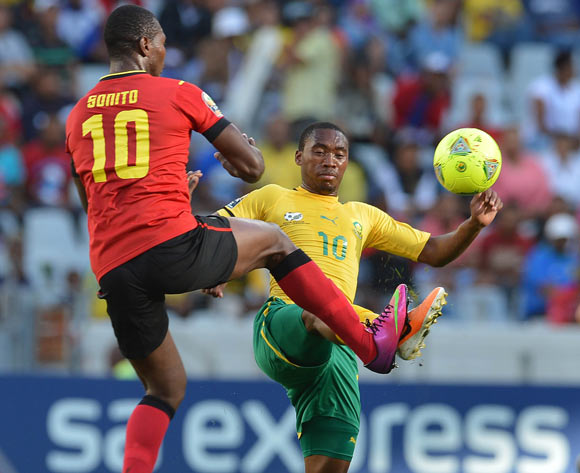 Sibusiso Vilakazi of South Africa battles for the ball with  Apsone Manjate of Mozambique during the 2014 CAF African Nations Championships Group A football match between South Africa and Mozambique at Cape Town Stadium, Cape Town on 11 January 2014