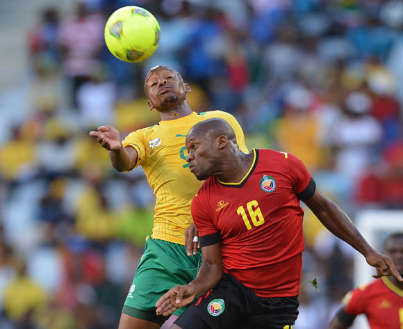 Katlego Mashego of South Africa battles for the ball with Almiro Lobo of Mozambique during the 2014 CAF African Nations Championships Group A football match between South Africa and Mozambique at Cape Town Stadium, Cape Town on 11 January 2014