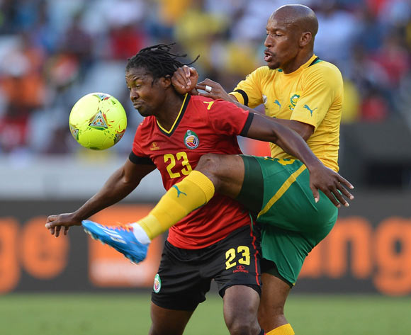 Katlego Mashego of South Africa battles for the ball with Guilherme Manhique of Mozambique during the 2014 CAF African Nations Championships Group A football match between South Africa and Mozambique at Cape Town Stadium, Cape Town on 11 January 2014