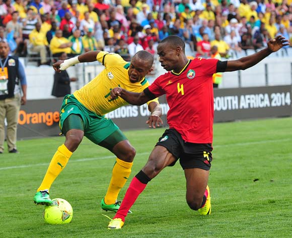 Bernard Parker of South Africa takes on Saddan Guambe of Mozambique during the 2014 CAF African Nations Championships Group A football match between South Africa and Mozambique at Cape Town Stadium, Cape Town on 11 January 2014