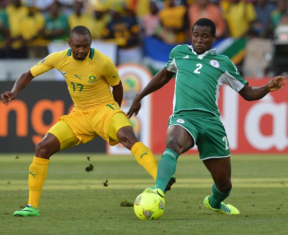 Solomon Kwambe of Nigeria battles for the ball with Bernard Parker of South Africa during the 2014 CAF African Nations Championships Group A football match between Nigeria and South Africa at Cape Town Stadium, Cape Town on 19 January 2014