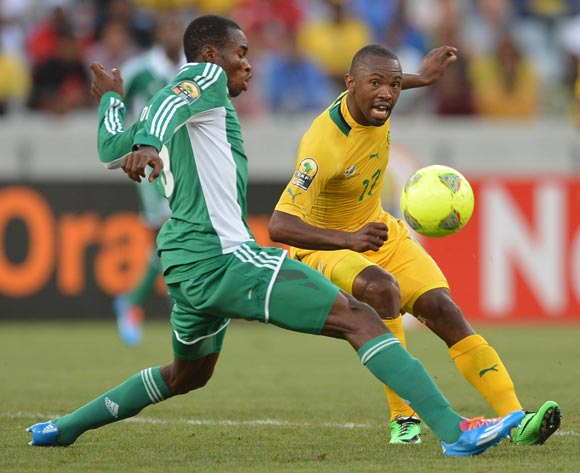 Bernard Parker of South Africa evades challenge from Kunle Odunlami of Nigeria during the 2014 CAF African Nations Championships Group A football match between Nigeria and South Africa at Cape Town Stadium, Cape Town on 19 January 2014