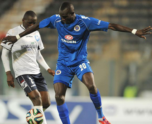 Mame Niang of Supersport United challenged by James Situma of AFC Leopards during the CAF Confederations Cup match between Supersport United and AFC Leopards at Lucas Moripe Stadium in Atteridgeville on the 01 March 2014