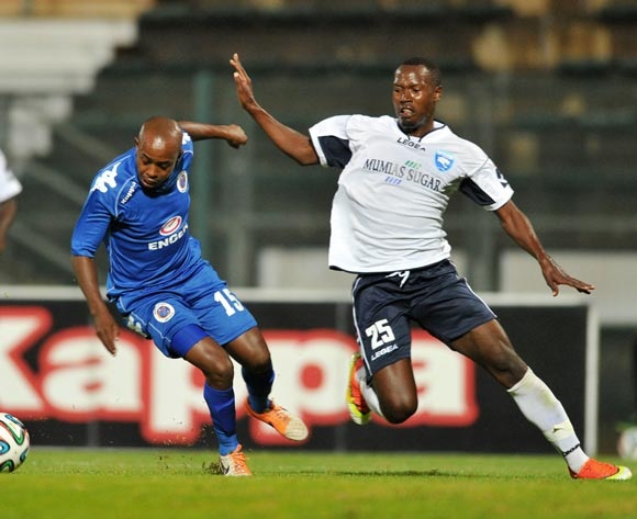 Bennett Chenene of Supersport United challenged by Musa Mudde of AFCLeopards during the CAF Confederations Cup match between Supersport United and AFC Leopards at Lucas Moripe Stadium in Atteridgeville on the 01 March 2014