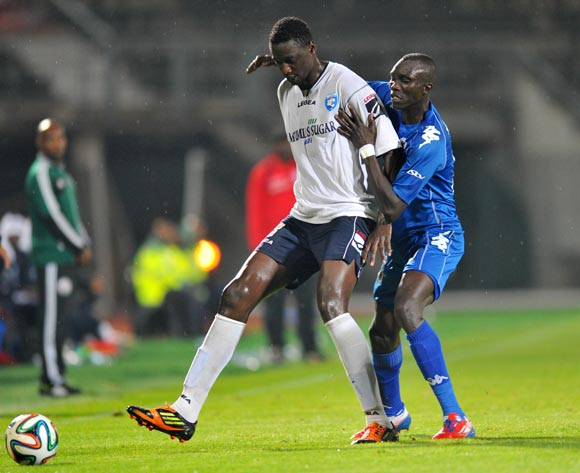 Joseph Shikokoti of AFC Leopards challenged by Mame Niang of Supersport United during the CAF Confederations Cup match between Supersport United and AFC Leopards at Lucas Moripe Stadium in Atteridgeville on the 01 March 2014