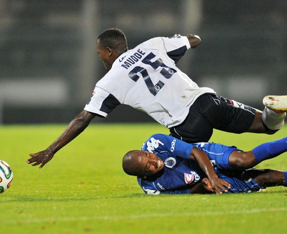 Bennett Chenene of Supersport United challenged by Musa Mudde of AFC Leopards during the CAF Confederations Cup match between Supersport United and AFC Leopards at Lucas Moripe Stadium in Atteridgeville on the 01 March 2014