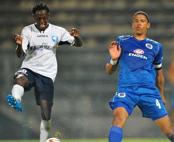 Jacob Keli of AFC Leopards challenged by Bevan Fransman of Supersport United during the CAF Confederations Cup match between Supersport United and AFC Leopards at Lucas Moripe Stadium in Atteridgeville on the 01 March 2014