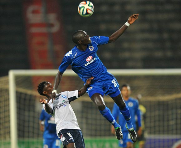 Mame Niang of Supersport United challenged by Jacob Keli of AFC Leopards during the CAF Confederations Cup match between Supersport United and AFC Leopards at Lucas Moripe Stadium in Atteridgeville on the 01 March 2014