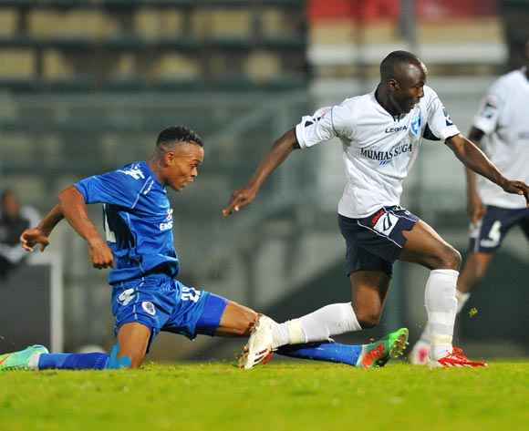 Augastine Etemesi of AFC Leopards challenged by Aupa Moeketsi of Supersport United during the CAF Confederations Cup match between Supersport United and AFC Leopards at Lucas Moripe Stadium in Atteridgeville on the 01 March 2014