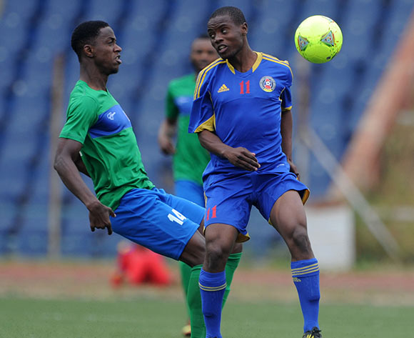 Khalifa Jabbie of Sierra Leone challenged by Mxolisi Lukhele of Swaziland during the African Cup of Nations Qualifiers match between Swaziland and Sierra Leone in Somhlolo Stadium,  Mbabane on the 18 May 2014