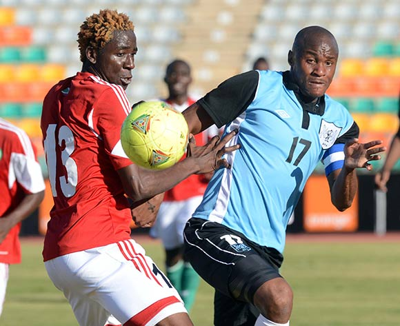 Joel Mogorosi of Botswana battles with Frederic Nsabiyomva of Burundi during the 2015 African Cup of Nations Qualifier match between Botswana and Burundi on the 01 June 2014 at Lobatse Sports Complex in Botswana