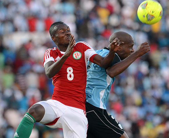 Tshireletso Leutlwetse of Botswana battles with Fiston Abdoul of Burundi during the 2015 African Cup of Nations Qualifier match between Botswana and Burundi on the 01 June 2014 at Lobatse Sports Complex in Botswana