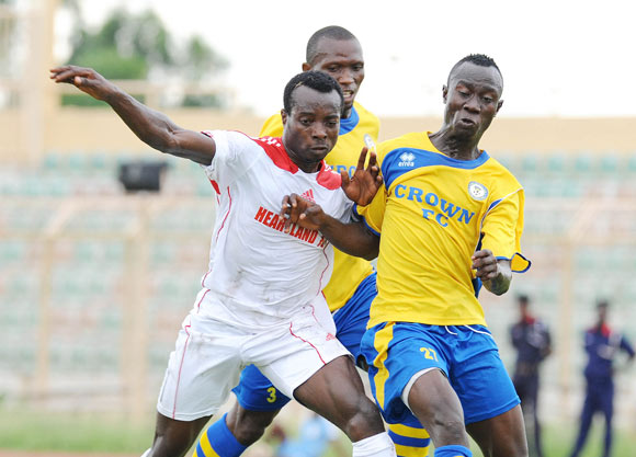 Seun Akinyemi of Crown fc challenge Ohawuche Staley of Heartland fc