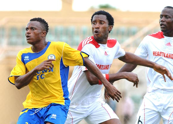 Ibrahim Babalola of Crown fc against Efugu Chinedu of Heartland fc