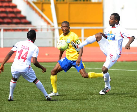 Alhassan Yusuf of Gombe United challenges Meshack Chibuikem and Dada Bitrus of Rangers during the 2013 Nigeria Professional Football League Match between Rangers and Gombe United on August 18, 2013 at Nnamdi Azikiwe Stadium, Enugu ©Norbert Okolie/Backpage
