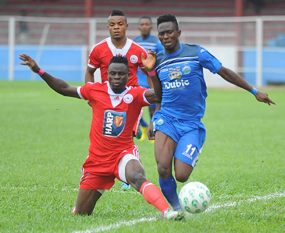 Mathew Etim of Rangers tackles Andrew Abalogu of Enyimba during the Glo Nigeria Premier League 2014  match between Enyimba and Rangers on March 16, 2014 at Enyimba Stadium, Aba, Abia state