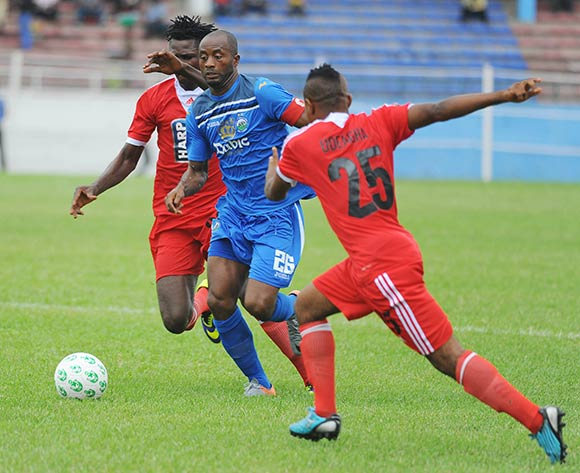 Chinedu Udoji of Enyimba is challenged by Sunday Chinedu and Ighodalo Osagona of Rangers during the Glo Nigeria Premier League 2014  match between Enyimba and Rangers on March 16, 2014 at Enyimba Stadium, Aba, Abia state