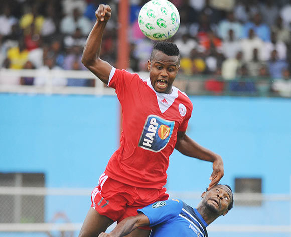 Ugonna Uzochukwu of Rangers in aerial challenge with Ayo Saka of Enyimba during the Glo Nigeria Premier League 2014  match between Enyimba and Rangers on March 16, 2014 at Enyimba Stadium, Aba, Abia state
